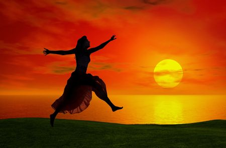 Silhouette of a woman jumping at the sunset  photo