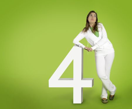 Woman contemplating questions with 3D forms on a green background Stock Photo - 1207272