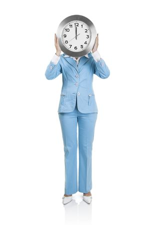 Business active woman standing over a white background with a clock on the face photo