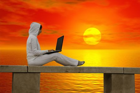 girl notebook: Woman working with is laptop at the sunset Stock Photo