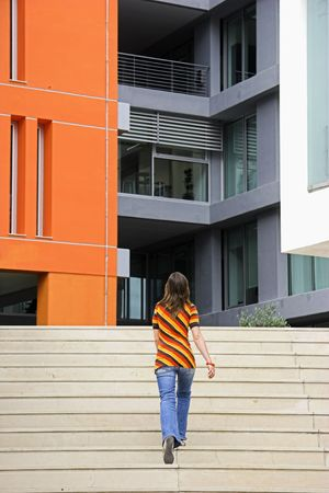 A young woman walking through the stairs of modern building Stock Photo - 1320471