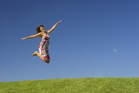Happy woman on a beautiful green meadow photo
