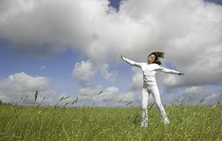 Beautiful happy woman having fun in the nature Stock Photo - 1684667