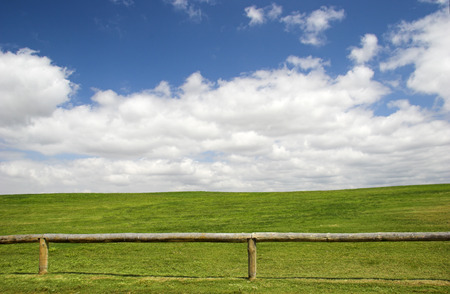Beautiful meadow with a great blue sky and wooden fence Stock Photo - 1693712