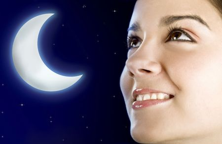 Portrait of a beautiful happy woman at night (moon created in PS) photo