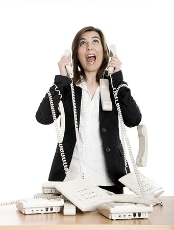 Busy woman working and answering a lot of calls at the same time Stock Photo - 2532418