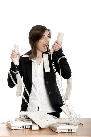 Busy woman working and answering a lot of calls at the same time photo
