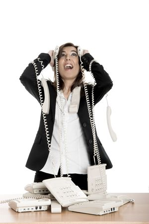 Busy woman working and answering a lot of calls at the same time Stock Photo - 2532436