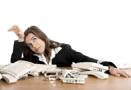 Busy woman working and answering a lot of calls at the same time Stock Photo - 2532427