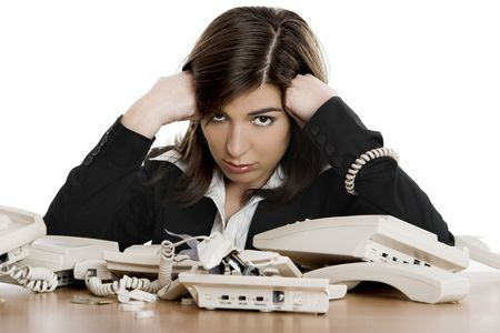 Busy woman working and answering a lot of calls at the same time Stock Photo - 2532764