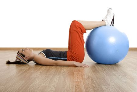 Beautiful young woman making exercises with a core ball photo