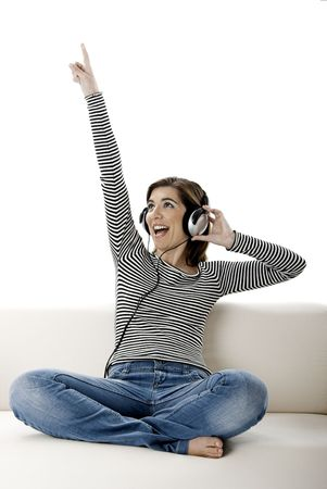 Beautiful happy woman listen music with headphones photo