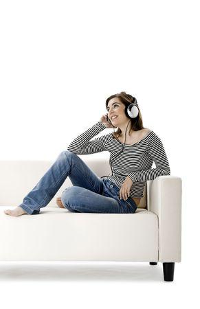Beautiful happy woman listen music with headphones photo