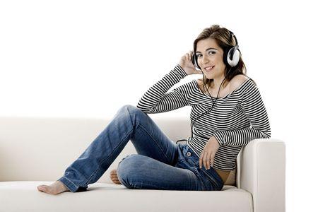 Beautiful happy woman listen music with headphones Stock Photo - 2701876
