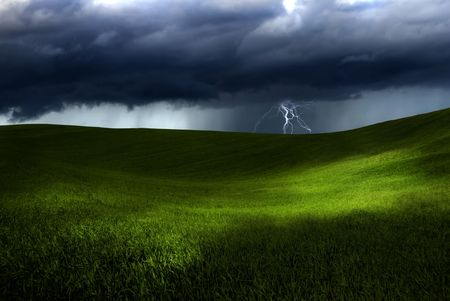 Beautiful green meadow with storm clouds and thunders  photo