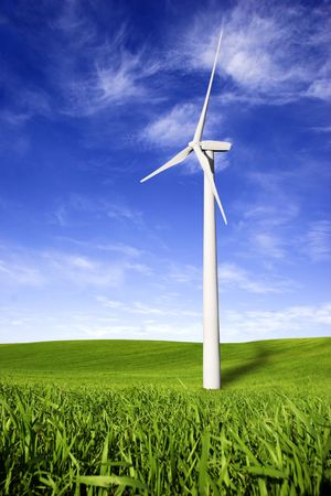 Beautiful green meadow with Wind turbines generating electricity photo