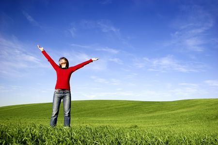 Young woman relaxing on a beautiful green meadow Stock Photo - 2995896