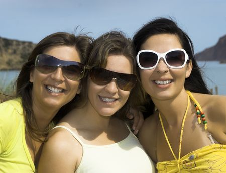 Portrait of three young girls with the beach on the  background Stock Photo - 3182952