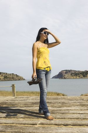 Young and beautiful woman on the beach Stock Photo - 3182950