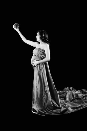 and guessing: Beautiful Pregnant woman holding a Crystal Ball with a beautiful dress