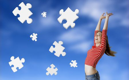 Beautiful woman happy with the solutions for her problems - Concept with 3d puzzle pieces floating in the sky photo