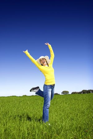 happy woman on a beautiful green meadow Stock Photo - 3280150
