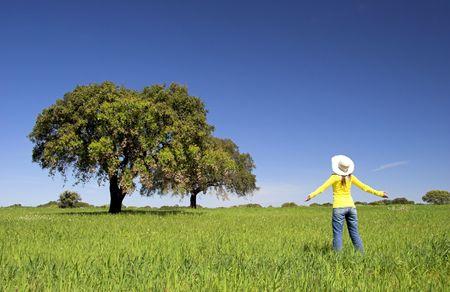 happy woman on a beautiful green meadow Stock Photo - 3280151