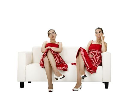 preety: Two twin sisters seated on a couch upset with themselves - Picture collage of the same woman in diferent poses