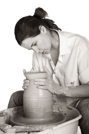 Picture of a potter works a potters wheel photo
