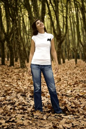 Beautiful happy woman in the Autumn Park photo
