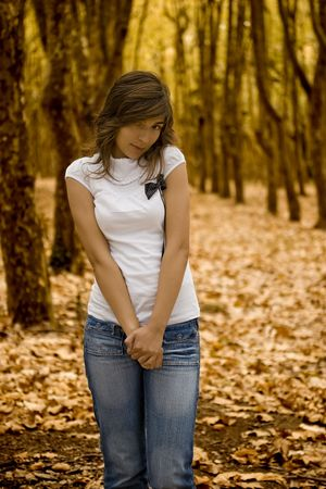 Shy woman in the Autumn Park photo