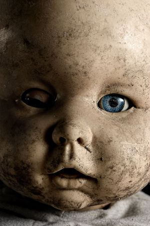 Close-up of baby doll with only on eye opened photo