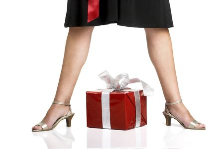 Picture of a young attractive woman with a red gift under her legs photo
