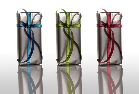 Beautiful colored Christmas boxes isolated on white with reflection  photo