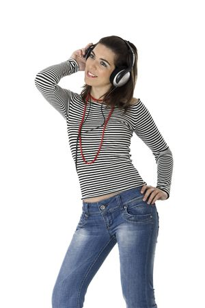 Beautiful young woman listening music with headphones isolated on white background photo