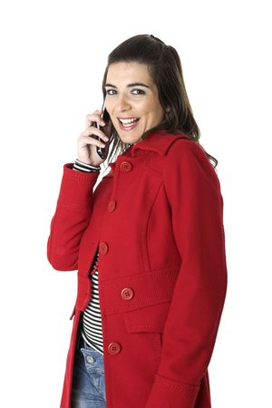 Beautiful young woman with a red coat talking at phone photo