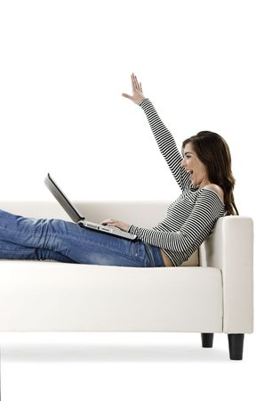 Beautiful and happy young woman working with a laptop photo