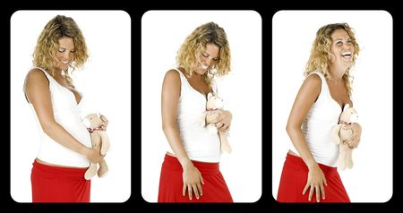 Beautiful pregnant woman with a teddy bear, isolated on white background   photo