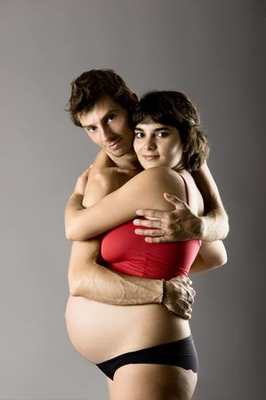 Beautiful happy couple in love expecting a baby Stock Photo - 4242608