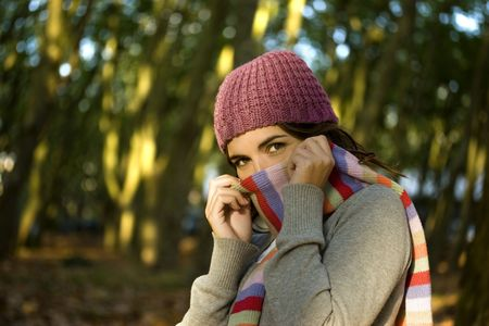 Autumn portrait of a beautiful happy young woman with a colored scarf photo