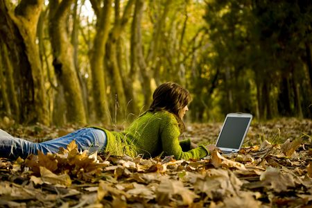 Beautiful young woman using laptop at outdoor Stock Photo
