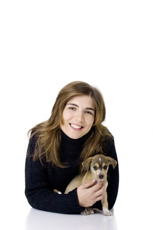 Portrait of a happy woman with her cute puppy photo