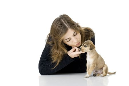 Portrait of a girl embracing her best friend, A beautiful and adorable puppy photo