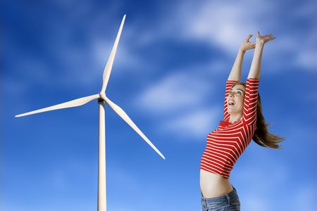Beautiful happy woman with a windmill in the beackground. Stock Photo - 4422537