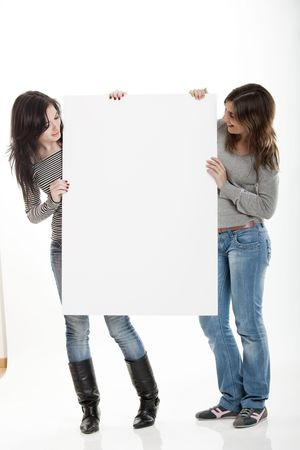 notecard: Portrait of two beautiful young women holding a blank notecard.