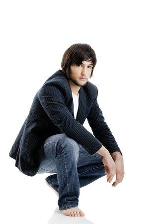 jeune mec: Jeune homme debout sur un fond blanc Banque d'images