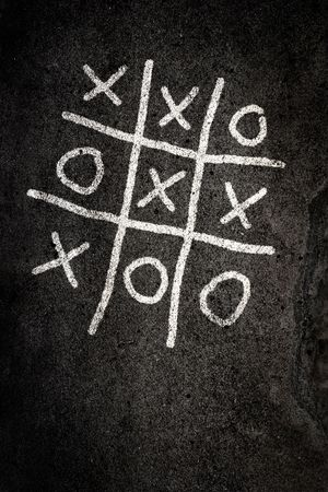 Noughts and Crosses game on paving Stock Photo - 4500980