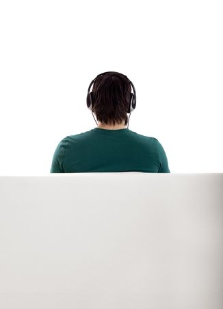Back view from a young man seated on the couch  photo
