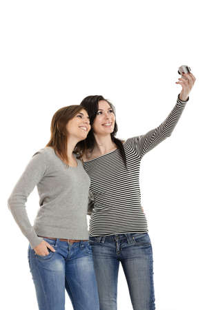 Two beautiful young woman taking self portraits photo