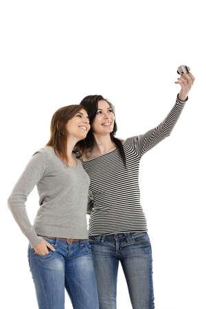 Two beautiful young woman taking self portraits photo